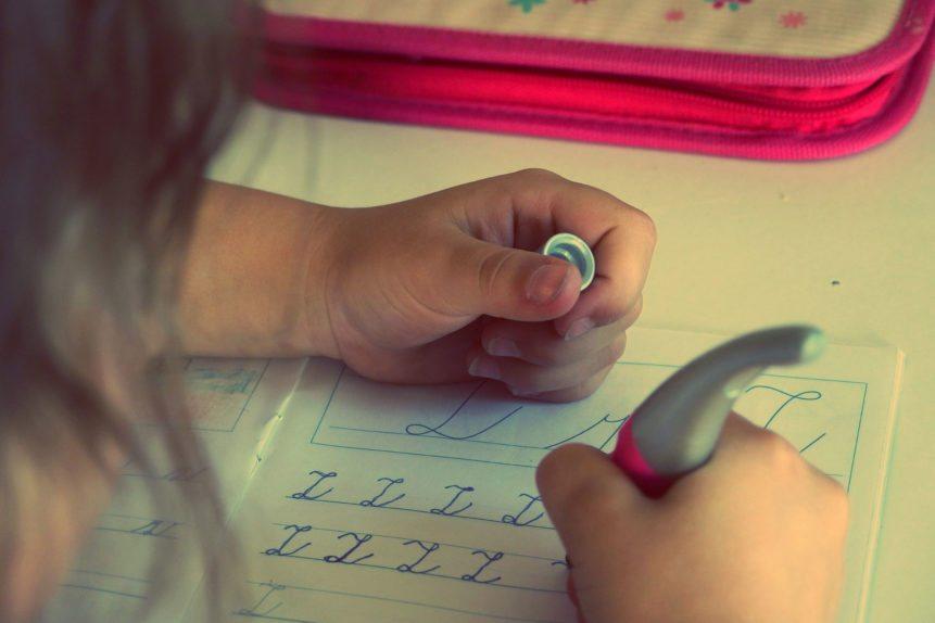 The child writes homework